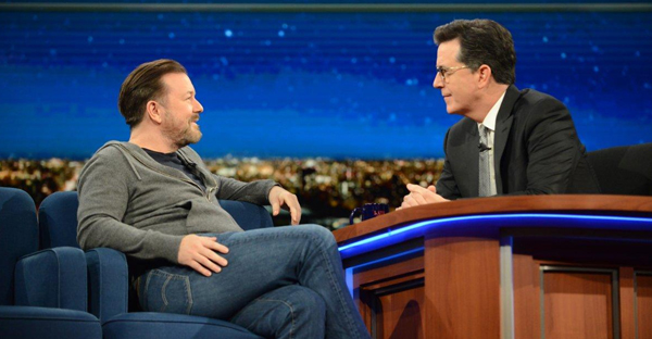 "Stephen Colbert and Ricky Gervais tried to convince each other about the existence of God on ""The Late Show"" Wednesday night. (MARY KOUW/CBS)"
