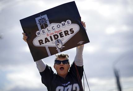 Labor union member Geraldine Lacy celebrates Monday, March 27, 2017, in Las Vegas. NFL team owners approved the move of the Raiders to Las Vegas in a vote at an NFL football annual meeting in Phoenix. (AP Photo/John Locher)