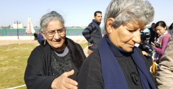 Nabila Halim, pictured right, is consoled by her sister at a government hostel in Ismailia. (CNN)