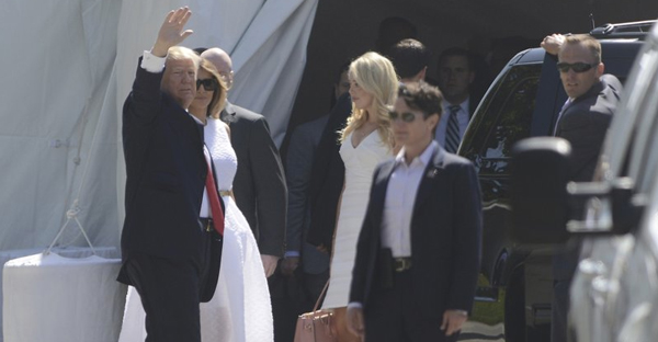 President Donald Trump, accompanied by first lady Melania Trump waves to onlookers as he enters Episcopal Church of Bethesda-by-the-Sea in Palm Beach, Fla., for an Easter Service, Sunday, April 16, 2017. (Joe Cavaretta/South Florida Sun-Sentinel via AP)