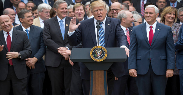President Trump and Vice President Mike Pence with House Republicans on May 4, after the House passed legislation to repeal major parts of the Affordable Care Act. (Credit: Stephen Crowley/The New York Times)
