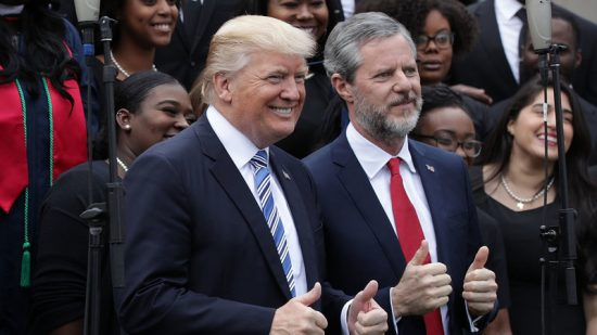 President Trump poses with Liberty University President Jerry Falwell Jr., during commencement at Liberty University May 13 in Lynchburg, Va. Alex Wong/Getty Images