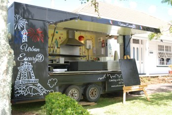 Urban Escargot Black Food truck with blackboard outside ready for a special event