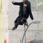 "Andrew Garfield films a stunt where he uses his superpowers to avoid being hit by a car on his skateboard on the set of ""The Amazing Spider-Man"""