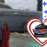 USA River Cruises in front of the American Constellation