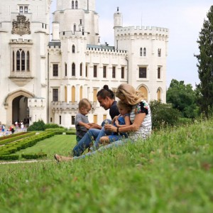 Jessica and Garrett gather for a photo at the historic Hluboká Castle in the Czech Republic.