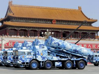 Military vehicles carrying shore-to-ship missiles drive past the Tiananmen Gate during a military parade to mark the 70th anniversary of the end of World War Two in Beijing | Image: Reuters