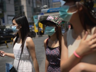 Residents of Seoul wearing surgical masks during the 2015 Middle East respiratory syndrome (MERS) outbreak in South Korea | Image: British Broadcasting Company (BBC)