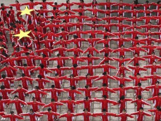 Pupils stand to form a giant Chinese national flag to celebrate the upcoming 60th anniversary of the founding of the People's Republic of China at a primary school in Dexing, Jiangxi province on 22 September 2009 I Image: Reuters/China Daily