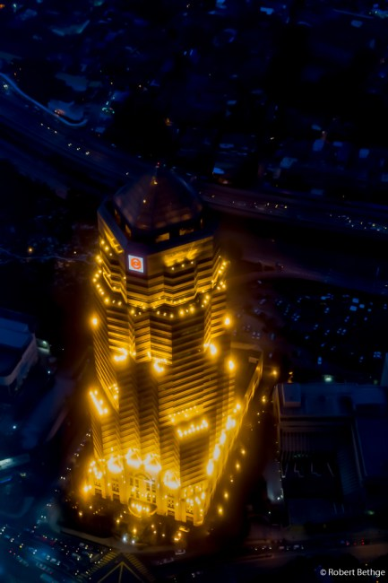 Beautifully lit building next to the Petronas Towers