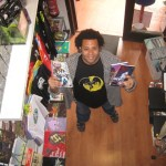 miguel with comics and bat shirt