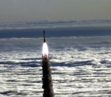 NASA photo of a rocket soaring above the clouds