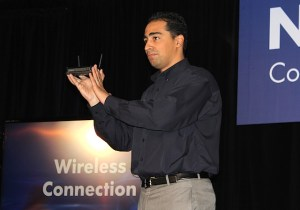 Netgear vice president David Henry shows off a router.