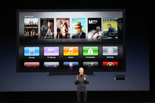 Apple CEO Tim Cook announces the new Apple TV at a press event, March 7, 2012, in San Francisco.