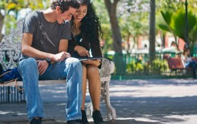 couple dating looking at an ipad