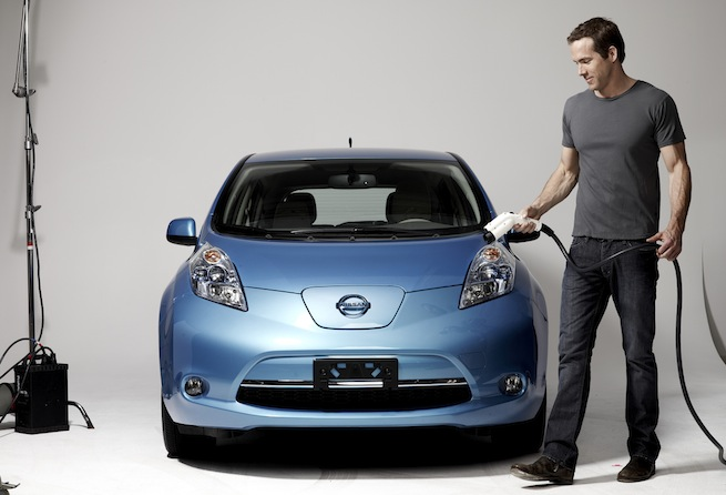 Actor and environmentalist Ryan Reynolds recharges an electric Nissan Leaf