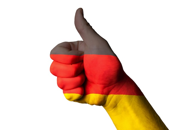 German flag laid over a thumbs-up hand