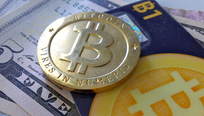 A physical Bitcoin on a variety of currency