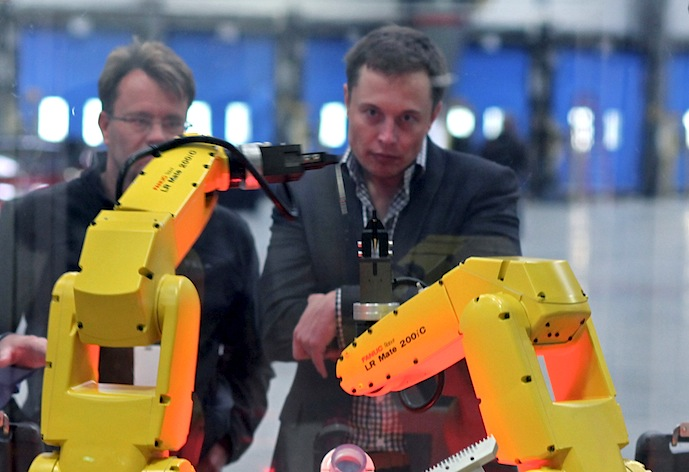 Elon Musk watches robots at the Tesla Motors plant (formerly NUMMI Plant)