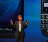 BlackBerry CEO Thorsten Heins holding the Z10 and Q10 phones