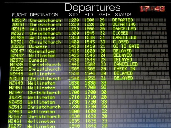 departures board showing many canceled flights