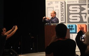 Tim Berners Lee photographs people in the crowd at SXSW 2013