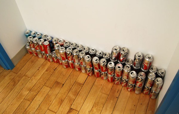 Diet Coke cans stacked in a hallway