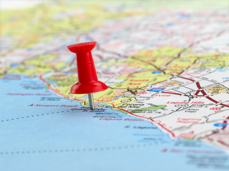 Closeup of a red pushpin on a map