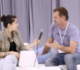 CEO Peter Koch being interviewed at a fashion trade show.
