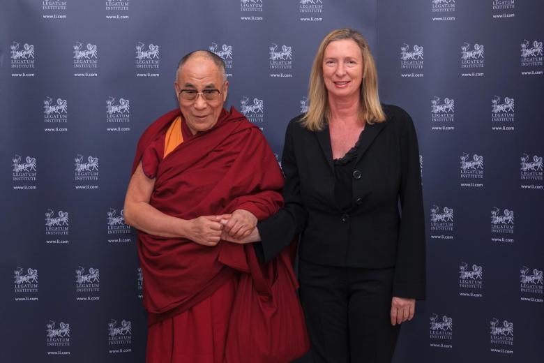 Razoo CEO Lesley Mansford with the Dalai Lama.