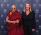 Razoo CEO Lesley Mansford with the Dalai Lama.
