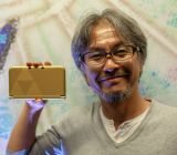 Zelda producer Eiji Aonuma with the new Zelda-branded 3DS XL.