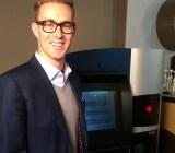 RoboCoin CEO Jordan Kelley with the world's first Bitcoin ATM