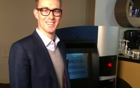 RoboCoin CEO Jordan Kelley with the world's first Bitcoin ATM