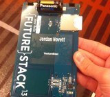 My connected FutureStack conference badge. The white chip on the right flashes oranges sometimes.
