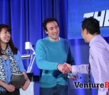 The ZowPow team -- founders Jennifer Lu and Brian Krejcarek -- collects their prize for winning the Who's Got Game competition.
