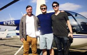 Fresh Jet's founders in front of a little plane.