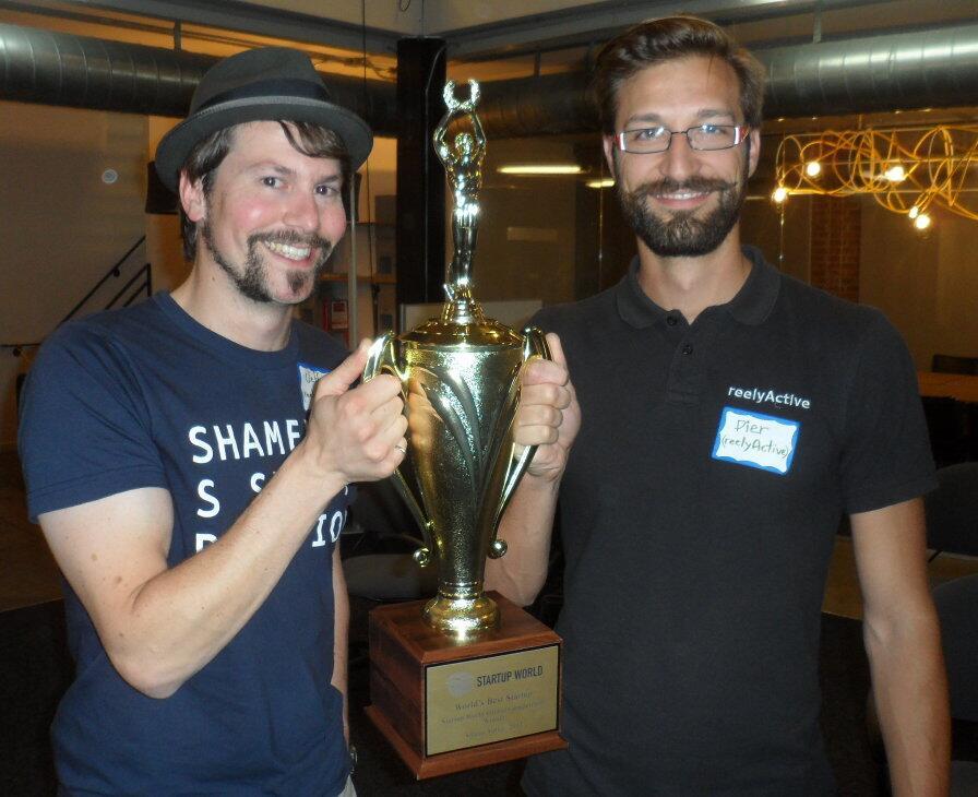 reelyActive's CEO Jeffrey Dungen and CTO Pier-Olivier Genest celebrate with their award