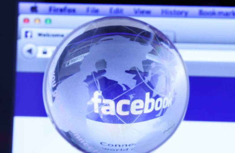 Facebook's webpage seen through a glass globe.