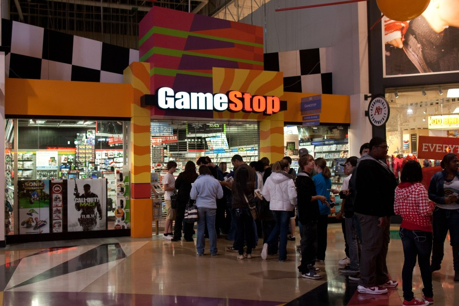 Gamers line up for a midnight launch at GameStop.