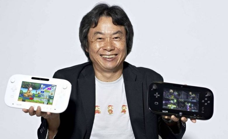 Nintendo's Shigeru Miyamoto with the Wii U's Gamepad controller.