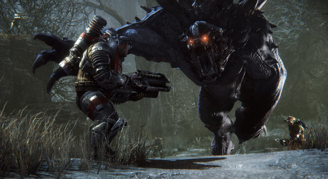 Evolve monster charges a human hunter.