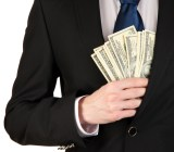 hand suit money Africa Studio shutterstock