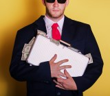 money suitcase Zsolt Biczo shutterstock