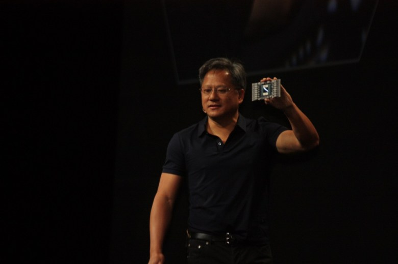 Nvidia CEO Jen-Hsun Huang with a Pascal chip