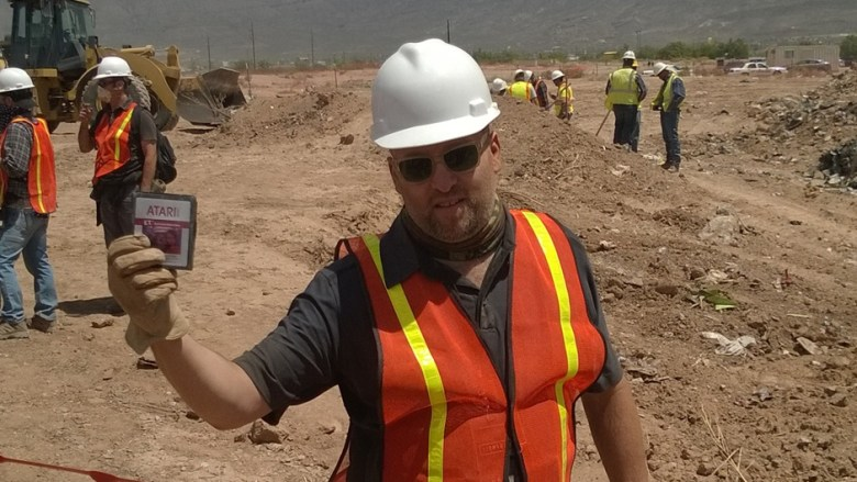 An excavator finds Atari E.T. game cartridges in a New Mexico landfill.