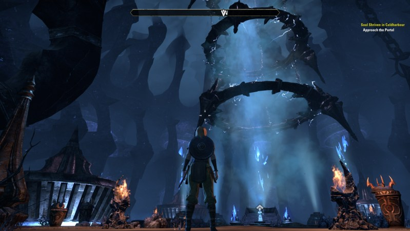 A third person view of a character staring at a Dark Achor, which is a vertical column of spiked circles and a glowing column of energy in the middle.