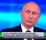 Vladimir Putin, listening yesterday to the translation of Edward Snowden's questions