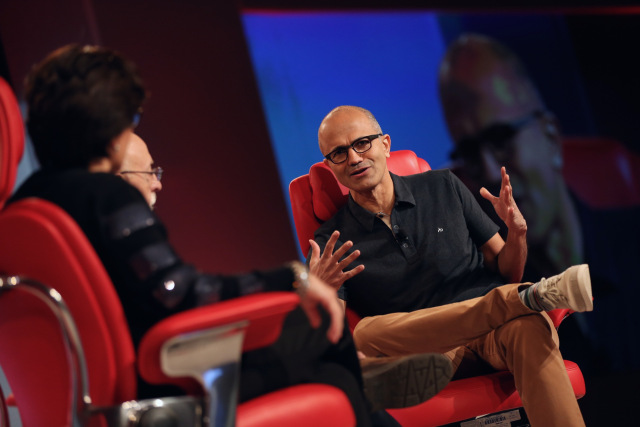 Microsoft chief executive Satya Nadella, right, speaks with Re/code's Kara Swisher (at left) and Walt Mossberg at Re/code's Code Conference today.