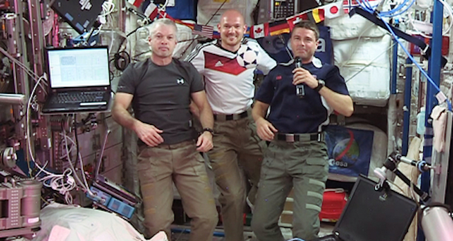 Astronauts aboard the International Space Station playing a bit of soccer without gravity.